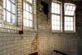 Filthy ceramic tiles wall with windows for horror background use Royalty Free Stock Photography