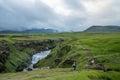 Fimmvorduhals trek in iceland trekker crossing green landscape during from skogar to porsmork passing eyjafjallajokull eruption Royalty Free Stock Images