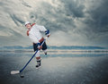 Final game. Hockey player on ice cube Royalty Free Stock Photo