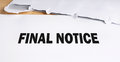Final notice opened on desk Royalty Free Stock Photo
