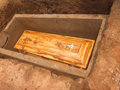 The final resting a coffin buried in tomb just to accompany person who is in her place Stock Photo