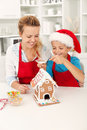 Final touches on the gingerbread house Stock Images