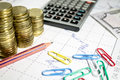 Finance business calculation with chart,calculator,color clips,pencil and coins Royalty Free Stock Photo