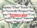 Finance concept business plan on money torn newspaper with words background d render Royalty Free Stock Photos
