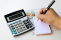 Finance personal and accounting with calculator money and black pencil on book bank Stock Image