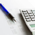 Finance report analysis concept using with pen and calculator Stock Photos