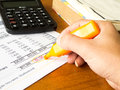Finance statement data with calculator and hand of someone Royalty Free Stock Photo