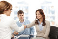 Financial advisor and client handshaking contemporary young couple get advise shaking hands Stock Images