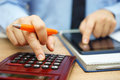 Financial analyst is calculating return on investment with papers and line data Royalty Free Stock Photo