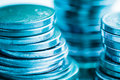 Financial blue background with coins macro closeup.