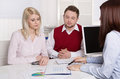 Financial business meeting: young married couple - adviser and c