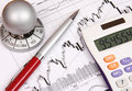 Financial chart with a calculator and a red pen Royalty Free Stock Photos