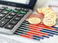 Financial concept calculator coins and graph d Royalty Free Stock Photo