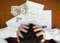 Financial crisis concept. Business man holding his head Royalty Free Stock Photo