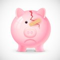 Financial crisis illustration of broken piggy bank with bandage Stock Photo