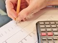 Financial data analyzing accounting with pencil and calculator Stock Image