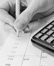 Financial data analyzing accounting with pencil and calculator Royalty Free Stock Photos