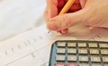 Financial data analyzing accounting with pencil and calculator Stock Photo