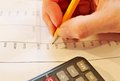 Financial data analyzing accounting with pencil and calculator Royalty Free Stock Image