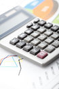 Financial data analyzing counting on calculator close up photo of and diagrams office desk selective focus Royalty Free Stock Images