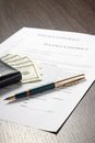 Financial document with wallet, money and fountain pen Royalty Free Stock Photo