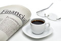 Financial newspaper with coffee and cup of on white background shallow depth of field Stock Images