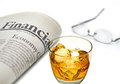 Financial newspaper with whiskey and glass ice on white background shallow depth of field Stock Photos