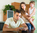 Financial problems in young family with child focus on man Stock Photos