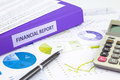 Financial report and graph analysis for budget management purple binder of place on graphs charts or business reports concept to Stock Image