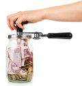 Financial reserves money conserved in a glass jar by female hand isolated on white Stock Photos