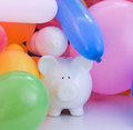 Financial success concept with piggy bank and balloons Stock Image