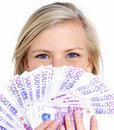 Financial success woman hiding behind money Royalty Free Stock Photos