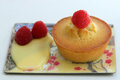 Financier with raspberries rasbberries and custard on pretty plate Stock Photos