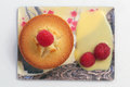 Financier with raspberries top view of rasbberries and custard on pretty plate Royalty Free Stock Photos