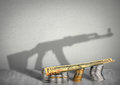Financing war concept money with weapon shadow terrorism Royalty Free Stock Photo