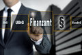 Finanzamt in german tax authorities vat income trade tax to touchscreen concept background Royalty Free Stock Photo