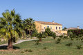 Finca in mallorca typical with palm trees and big garden just outside alcudia Stock Photos