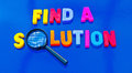 Find a solution text in colorful uppercase letters with letter o replaced by lens of hand magnifier to emphasize search for Royalty Free Stock Images
