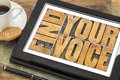 Find your voice concept creativity word abstract in letterpress wood type on a digital tablet with a cup of coffee Stock Photos