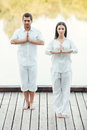 Finding peace together full length of beautiful young couple in white clothing meditating outdoors Stock Images