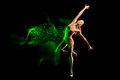 Fine art portrait of beautiful woman dancer in green sparkles Royalty Free Stock Photo