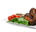 Fine bbq chicken a curated image from my series set legs with green spinach salad leaves and fresh tomatoes the perfect image for Royalty Free Stock Photo