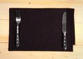 Fine cutlery on black placemat as menu board Royalty Free Stock Photo