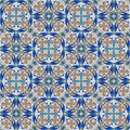 Fine oriental colorful carpet or ceramic ornament in orange and blue colors with white curves on black background