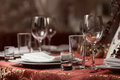 Fine restaurant dinner table place setting indoor. Royalty Free Stock Photo