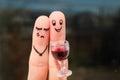 Finger art of couple. Woman is upset, man drunk.