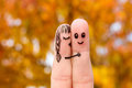 Finger art of a happy couple girl kisses boy on the cheek Stock Images