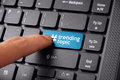Finger clicking Trending Topic on keyboard Royalty Free Stock Photo