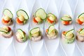 Finger food with fish and cucumbers Royalty Free Stock Photos