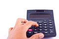 Finger hand put old dust button calculator for calculating the numbers accounting accountancy business and work hard    on white b Royalty Free Stock Photo